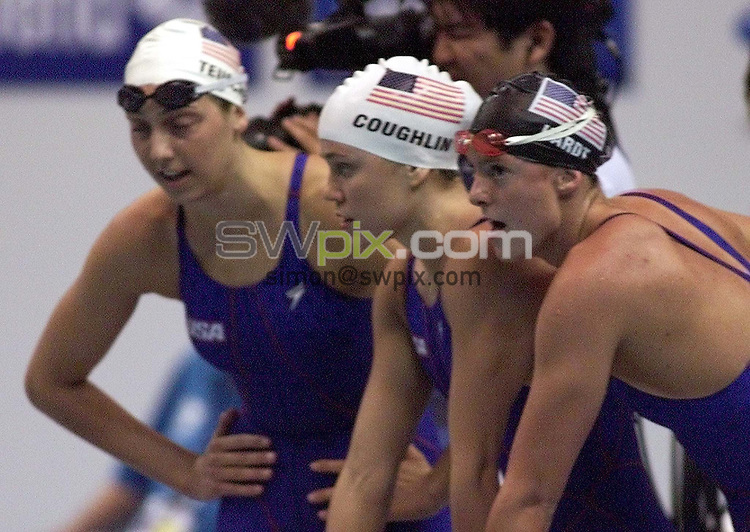 Pix: Patrick.B.Kramer/SWpix.com. Swimming,World Championships Fukuoka, Japan. 26/07/2001...COPYWRIGHT PICTURE>>SIMON WILKINSON>>01943 436649>>..From left to right Cristina Teuscher, Natalie Coughlin and Julie Hardt from the US 4x200m Freestyle Relay team after they have been disqualified on Wendsday, July 25th, 2001 final at the 9th World Swimming Championships in Marine Messe Stadion at Fukuoka. Great Britain won probably the Silver medal. Because of different appeals the result is not offical yet.