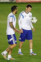 Lionel Messi of Argentina warming up during the training session with Ezequiel Lavezzi