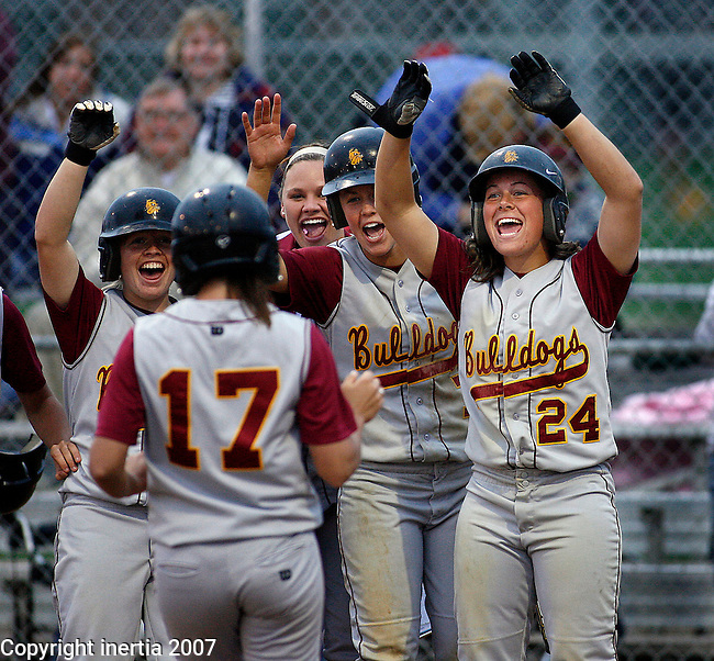 Sarah Kabes #24 of UM-Duluth gets ready to congratulate teammate Whitney Olson #17 after she homered in a game with University of Nebraska-Omaha Friday at the 2007 NCC Softball Championship at Sherman Park in Sioux Falls, S.D.  (Photo  by Dick Carlson/Inertia)