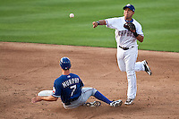 Round Rock Express shortstop Luis Hernandez #5 turns a double play during the MLB exhibition baseball game against the Texas Rangers on April 2, 2012 at the Dell Diamond in Round Rock, Texas. The Rangers out-slugged the Express 10-8. (Andrew Woolley / Four Seam Images).