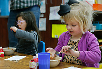 NWA Democrat-Gazette/DAVID GOTTSCHALK Cece Benfield, 5, lines up her cereal on her spoon during breakfast Monday, March 12, 2018, in her pre-school class at the Northwest Arkansas Sunshine School and Development Center in Little Flock. The school has been serving the area for more than 50 years.