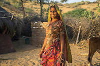Birju Devi, 45, a farmer's wife and participant in Technoserve's kitchen garden program, poses for a portrait at her home in Bamanwali village, Bikaner, Rajasthan, India on October 24th, 2016. Non-profit organisation Technoserve works with farmer's wives in Bikaner, providing technical support and training for edible gardening, to improve the nutritional quality of their food and relieve financial stress on farming communities. Photograph by Suzanne Lee for Technoserve
