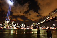 Tribute in Light 911 Memorial and the Brooklyn Bridge and Manhattan Skyline as seen from Brooklyn across the East River.