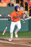 Left fielder Drew Wharton (13) of the Clemson Tigers bats in a game against the William and Mary Tribe on February 16, 2018, at Doug Kingsmore Stadium in Clemson, South Carolina. Clemson won, 5-4 in 10 innings. (Tom Priddy/Four Seam Images)
