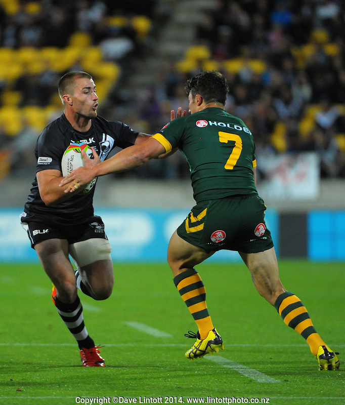 Kieran Foran runs at Cooper Cronk during the Four Nations rugby league final between the NZ Kiwis and Australia Kangaroos at Westpac Stadium, Wellington on Saturday, 15 November 2014. Photo: Dave Lintott / lintottphoto.co.nz