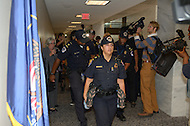 October 6, 2011  (Washington, DC)  U.S. Capitol Police arrest a lady as she protested at the Hart senate office building.  She was one of five people arrested for protesting the U.S. war efforts.  The demonstration was organized by the October 2011 group and Veterans For Peace.  (Photo by Don Baxter/Media Images International)