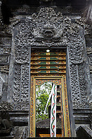 Jatiluwih, Bali, Indonesia.  Entrance to the Upper Level of Luhur Bhujangga Waisnawa Hindu Temple.  The deity Kala is above the doorway.