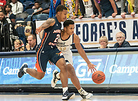 WASHINGTON, DC - NOVEMBER 16: Jameer Nelson Jr. #12 of George Washington dribbles by Isaiah Burke #2 of Morgan State during a game between Morgan State University and George Washington University at The Smith Center on November 16, 2019 in Washington, DC.