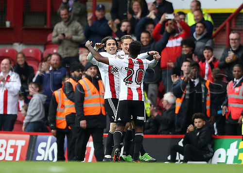 April 14th 2017,  Brent, London, England; Skybet Championship football, Brentford versus Derby County; Jota of Brentford celebrates scoring his sides 4th goal in the 90th minute to make it 4-0 with Konstantin Kerschbaumer of Brentford and Josh Clarke of Brentford