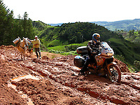 Riding through a mud road in Antioquia, Colombia. May 1, 2008..Born in Argentina, photographer Ivan Pisarenko in 2005  decided to ride his motorcycle across the American continent. While traveling Ivan is gathering an exceptional photographic document on the more diverse corners of the region. Archivolatino will publish several stories by this talented young photographer..Closer look at  Ivan's page www.americaendosruedas.com....