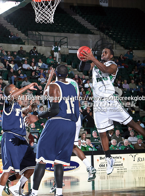 North Texas Mean Green forward George Odufuwa (4) grabs a rebound in the NCAA  basketball game between the Florida International University Panthers and the University of North Texas Mean Green at the North Texas Coliseum,the Super Pit, in Denton, Texas. UNT defeated FIU 87 to 77