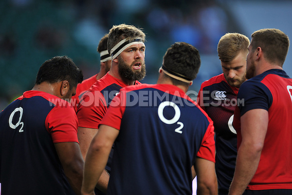 Geoff Parling of England speaks to his fellow forwards during the pre-match warm-up. QBE International match between England and France on August 15, 2015 at Twickenham Stadium in London, England. Photo by: Patrick Khachfe / Onside Images