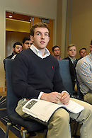 A student listening to a speaker at a seminar.