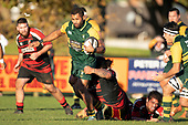 Peni Buakula is tackled during the Counties Manukau Premier Club Rugby game between Pukekohe and Papakura, played at Colin Lawrie Fields Pukekohe on Saturday June 9th 2018. Pukekohe won the game 37 - 22 after leading 15 - 10 at halftime. <br /> Photo by Richard Spranger.