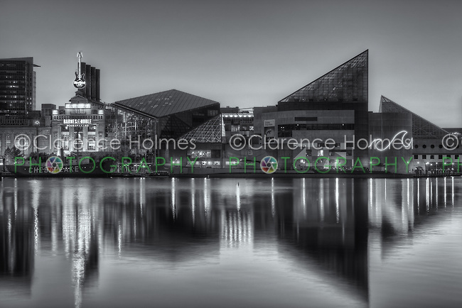 The National Aquarium reflects off the waters of the Inner Harbor during the last hour before sunrise in Baltimore, Maryland.