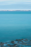 Guichen Bay has a colour of its own, or rather, many colours that are individual and distinct of that wide sweep of water. At dawn, across the characteristic wave-carved reefs, it is a milky turquoise.