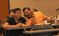 """NWA Democrat-Gazette/FLIP PUTTHOFF <br /> ESL GRAD AND DAD<br /> Bentonville High School student Diego Fuentes (left) and his dad, Herbert Fuentes, chat during breakfast at the """"Exit Celebration"""" held Wednesday Sept. 16 2015 at the high school to recognize students who completed the school's English as a second language program. Thirty-one students received certificates presented by Superintendent Mike Poore and school board members, said Ginger Mayes, English language development specialist for the Bentonville school district. Goals of the program include having student  graduate bi-lingual or multi-lingual and be leaders in the school and community."""