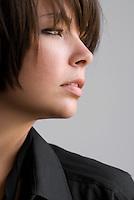 Female Model in Oxford Shirt in Side Profile