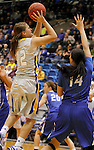 BROOKINGS, SD - NOVEMBER 18:  Macy Miller #12 from South Dakota State University takes the ball to the basket against Sydney Lamberty #14 from Creighton in the first half of their game Tuesday night at Frost Arena in Brookings. (Photo by Dave Eggen/Inertia)