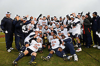 Virginia Cavaliers players and coaches pose with the NCAA national championship trophy. The Virginia Cavaliers defeated the Akron Zips 3-2 in a penalty kick shoot out after a scoreless game and overtime in the finals of the 2009 NCAA Men's College Cup at WakeMed Soccer Park in Cary, NC on December 13, 2009.