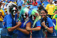 Italy supporters with painted faces and wigs on cheer their side on