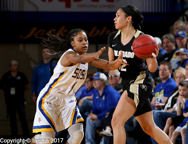 BROOKINGS, SD - MARCH 19:  Alexis Alexander #1 from South Dakota State applies pressure to Ariana Freeman #12 from Colorado during their second round WNIT game at Frost Arena March 19, 2017 in Brookings, South Dakota. (Photo by Dave Eggen/Inertia)