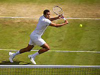 London, England, 3 July, 2016, Tennis, Wimbledon, Jo-Wilfried Tsonga (FRA) hits a volley in his match against John Isner (USA)<br /> Photo: Henk Koster/tennisimages.com