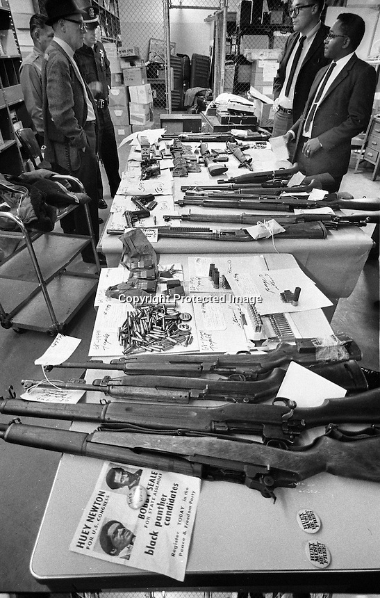 Oakland Police show off Black Panther Party guns and ammunition as well as a campaign poster for Huey Newton and Bobby Seale. (1968 photo by Ron Riesterer)