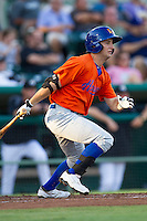 Midland RockHounds outfielder Conner Crumbliss (9) follows through on his swing during the Texas League baseball game against the San Antonio Missions on July 13, 2013 at Nelson Wolff Municipal Stadium in San Antonio, Texas. The Missions defeated the Rock Hounds 5-4. (Andrew Woolley/Four Seam Images)