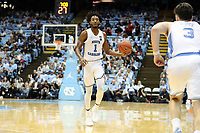 CHAPEL HILL, NC - NOVEMBER 01: Rechon Leaky Black #1 of the University of North Carolina hands the ball off to Andrew Platek #3 during a game between Winston-Salem State University and University of North Carolina at Dean E. Smith Center on November 01, 2019 in Chapel Hill, North Carolina.