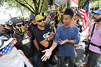 PORTLAND, OR - AUGUST 04: Someone from the public asks Joey Gibson and other Far-Right protesters about their reasons for being here during a gun rights' laws and free speech rally on August 4, 2018 in Portland, Oregon. (Photo by Karen Ducey/Getty Images)