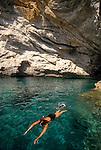 Crete, Greece, Woman swiming off southwest Crete shore, the Greek Isles, the Mediterranean Sea, Europe, sea caves, snorkeling, .
