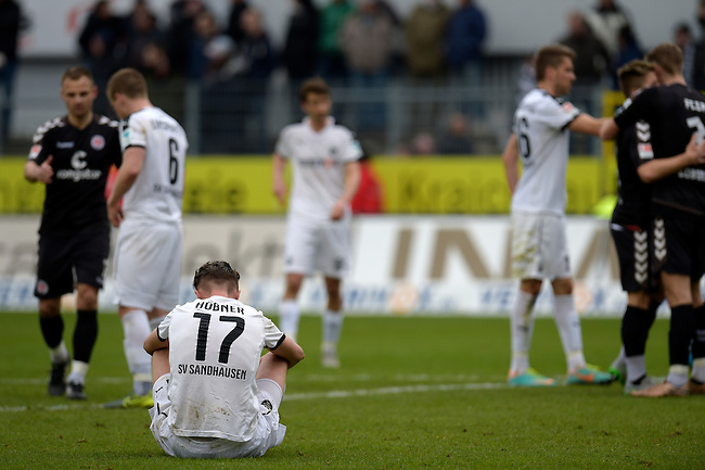 GER - Sandhausen, Germany, March 19: After the 2. Bundesliga soccer match between SV Sandhausen (white) and FC ST. Pauli (grey) on March 19, 2016 at Hardtwaldstadion in Sandhausen, Germany. (Photo by Dirk Markgraf / www.265-images.com) *** Local caption *** Florian Huebner #17 of SV Sandhausen sits on the ground