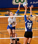 BROOKINGS, SD - SEPTEMBER 1:  Carley Gerving #9 from South Dakota State looks to get a kill past Makena Schoene #18 from Drake in the Jacks home opener Tuesday night at Frost Arena.  (Photo by Dave Eggen/Inertia)