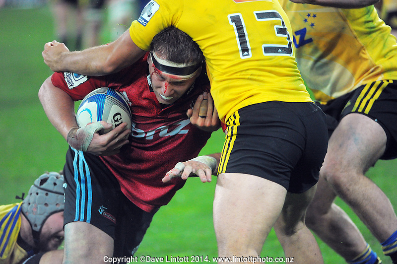 Wyatt Crockett is tackled during the Super Rugby match between the Hurricanes and Crusaders at Westpac Stadium, Wellington, New Zealand on Saturday, 28 June 2014. Photo: Dave Lintott / lintottphoto.co.nz