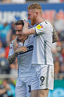 (L-R) Barrie McKay of Swansea City celebrates his goal with Oli McBurnie during the Sky Bet Championship match between Swansea City and Rotherham United at the Liberty Stadium, Swansea, Wales, UK. Friday 19 April 2019