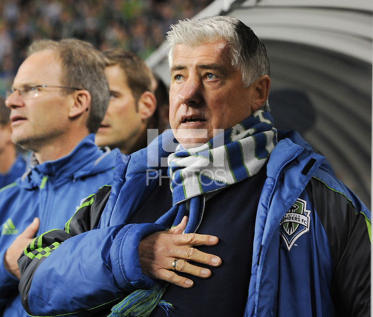 November, 2013: CenturyLink Field, Seattle, Washington: Seattle Sounders FC head coach Sigi Schmid during the US national anthem  as the Portland Timbers defeat  the Seattle Sounders FC 2-1 in the Major League Soccer Playoffs semifinals Round.