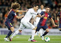 FC Barcelona's Carles Puyol (l) and Xavi Hernandez and Real Madrid's Cristiano Ronaldo during Copa del Rey - King's Cup semifinal second match.February 26,2013. (ALTERPHOTOS/Acero) /Nortephoto
