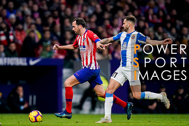 Diego Roberto Godin Leal of Atletico de Madrid (L) fights for the ball with Leonado Carrilho Baptistao, Leo Baptistao, of RCD Espanyol during the La Liga 2018-19 match between Atletico de Madrid and RCD Espanyol at Wanda Metropolitano on December 22 2018 in Madrid, Spain. Photo by Diego Souto / Power Sport Images