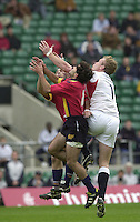 24/05/2002 (Friday).Sport -Rugby Union - London Sevens.England vs Spain.Steve White-Cooper challenges the Spanish defenders for the high ball.[Mandatory Credit, Peter Spurier/ Intersport Images].