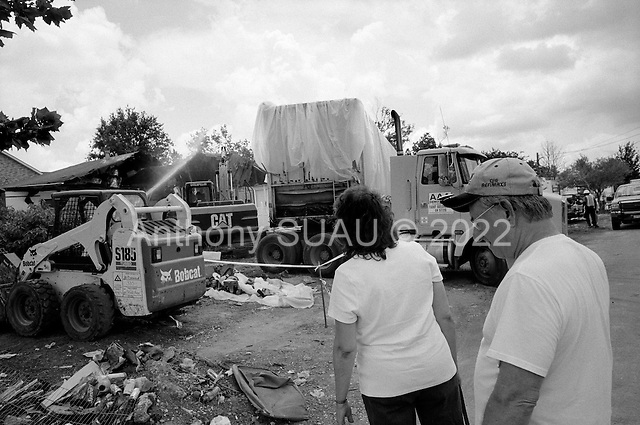 Saint Bernard's Parish, Louisiana.May 27, 2006..Linda and Tony Manalla, who are in their 60s, came to watch their home of 35 years be torn down after it was moved off its foundation by hurricane Katrina. They raised 3 girls in that house and Linda's parents lived just across the street until they died last year a few months before Katrina hit...They have since purchased a home in Slidell. ..FEMA funded demolition teams work at leveling 6,000+  homes in St. Bernard's Parish damaged by hurricane Katrina in August of 2005...FEMA is offering to destroy homes for free up until June 30, 2006. About 12 homes are being demolished daily.
