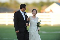 NWA Democrat-Gazette/ANDY SHUPE<br /> Emily Carpenter smiles Friday, Sept. 25, 2015, as she walks with her father, Tim Carpenter, after being selected Har-Ber High School homecoming queen at Wildcat Stadium at Har-Ber High School in Springdale. Visit nwadg.com/photos to see more photographs from the ceremony.