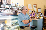 "Melvin Safra, 70, owner of Bagel Time stands in his restaurant in Miami Beach, Florida July 17, 2011. He has not retired and still works 12 hours a day. ""In this economy, who can retire?"" he asked...Kendrick Brinson/LUCEO"