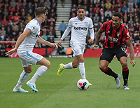 Bournemouth's Callum Wilson (right) under pressure from West Ham United's Aaron Cresswell (left) and Pablo Fornals (centre)<br /> <br /> Photographer David Horton/CameraSport<br /> <br /> The Premier League - Bournemouth v West Ham United - Saturday 28th September 2019 - Vitality Stadium - Bournemouth<br /> <br /> World Copyright © 2019 CameraSport. All rights reserved. 43 Linden Ave. Countesthorpe. Leicester. England. LE8 5PG - Tel: +44 (0) 116 277 4147 - admin@camerasport.com - www.camerasport.com