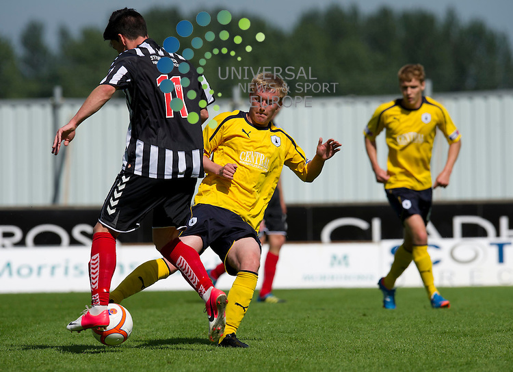 Craig Sibbald of Falkirk challenges for the ball against Daniel Moore of Elgin City during the Communities League Cup first round match between Falkirk and Elgin City at The Falkirk Stadium. 4 August 2012. Picture by Ian Sneddon / Universal News and Sport (Scotland). All pictures must be credited to www.universalnewsandsport.com. (Office) 0844 884 51 22.