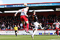 Marcus Haber of Stevenage beats Shaun Williams of MK Dons to a header. Stevenage v MK Dons - npower League 1 -  Lamex Stadium, Stevenage - 27th April, 2013. © Kevin Coleman 2013. ..