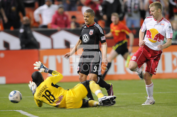 DC United forward Charlie Davies (9) goes against New York Red Bulls goalkeeper Bouna Coundoul (18) The New York Red Bulls defeated DC United 4-0, at RFK Stadium, Thursday April 21, 2011.