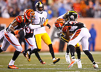 Markus Wheaton #11 of the Pittsburgh Steelers is hit by Shawn Williams #36 of the Cincinnati Bengals after catching a pass in the second quarter during the Wild Card playoff game at Paul Brown Stadium on January 9, 2016 in Cincinnati, Ohio. A penalty was called on the Cincinnati Bengals on the play for the hit. (Photo by Jared Wickerham/DKPittsburghSports)