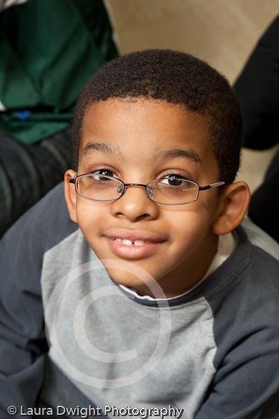 Education Elementary school Grade 2 closeup portrait of boy vertical wearing eyeglasses