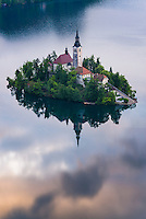Slovenia landscape. Lake Bled Island reflections and the Church of the Assumption of St Mary at sunrise, Gorenjska, Slovenia, Europe